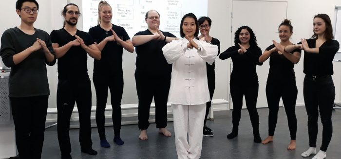 Tai chi group greets with respect